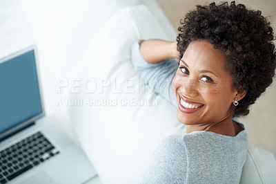 Buy stock photo High angle view of smiling African American woman using laptop on couch