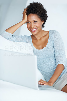 Buy stock photo Happy African American woman thinking while using laptop at home
