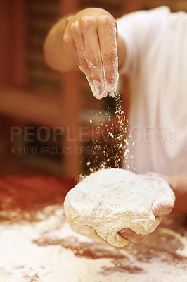 Buy stock photo Hands sprinkling flour on a ball of dough