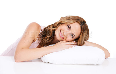 Buy stock photo A beautiful young woman resting her head on a white pillow against a white background