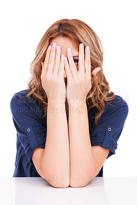 Buy stock photo A beautiful young woman hiding her face with her hands while isolated on white, one eye visible between fingers