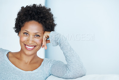 Buy stock photo Portrait of beautiful young woman smiling while sitting on couch