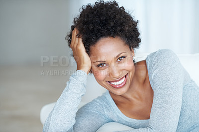 Buy stock photo Portrait of attractive African American woman smiling while lying on couch