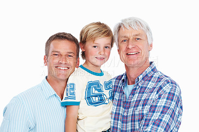 Buy stock photo Shot of a child standing with his father and grandfather over a white background