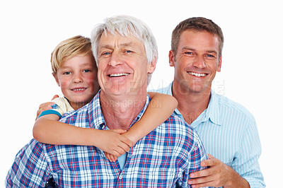Buy stock photo Closeup of cute boy enjoying piggyback ride with grandfather and father