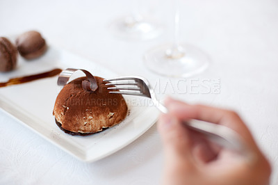 Buy stock photo Shot of an unrecognizable person reaching for a bit of an elegant dessert at a restaurant