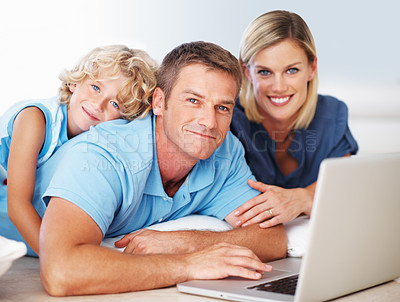 Buy stock photo Portrait of smiling middle aged man using laptop with beautiful woman and son