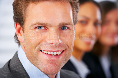 Buy stock photo Business man attending a meeting with his colleagues in the background