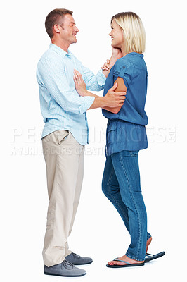Buy stock photo Full length shot of a happy middle aged couple standing together over a white background
