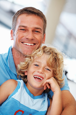 Buy stock photo Portrait of happy mid adult man smiling with cute little son