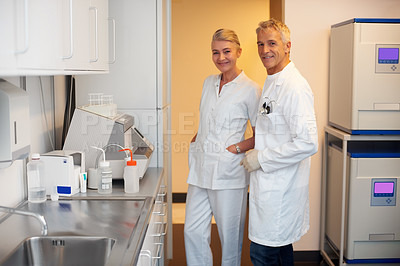 Buy stock photo Two happy mature science technicians working in laboratory