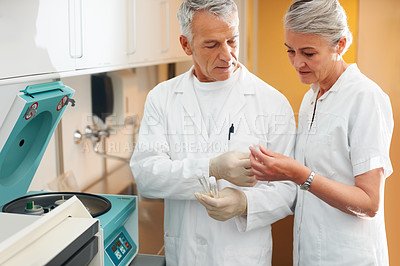 Buy stock photo Two science technicians survey the results of their experiments in lab