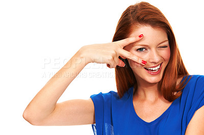 Buy stock photo Portrait of a pretty redhead looking at you through her fingers - Isolated