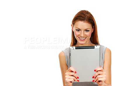 Buy stock photo A young woman looking at something interesting on her digital tablet