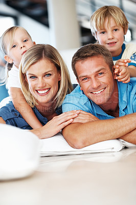 Buy stock photo Portrait of beautiful middle aged woman and man smiling with kids on floor