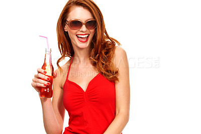 Buy stock photo Portrait of a  young redhead holding a bottle of soda while smiling and isolated on white