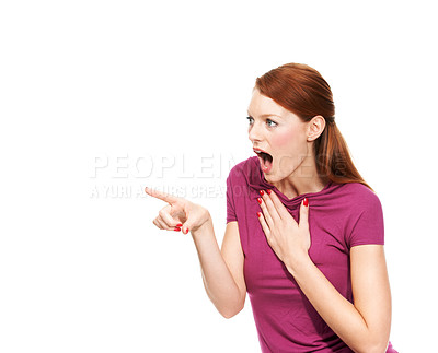 Buy stock photo A young attractive woman gasping with her hand to her chest in surprise