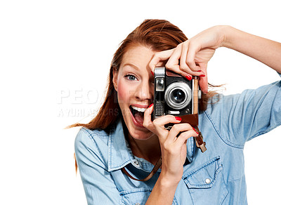 Buy stock photo Portrait of a young woman laughing at you from behind a camera