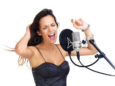 Buy stock photo Beautiful brunette singing into a microphone swinging her arms rhythmically over her head - isolated