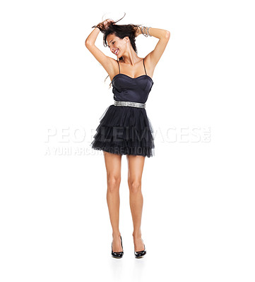 Buy stock photo Attractive young brunette dancing joyfully with her arms raised above her head - isolated