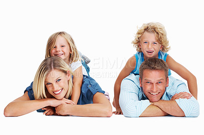 Buy stock photo Portrait of a happy family lying against a white background