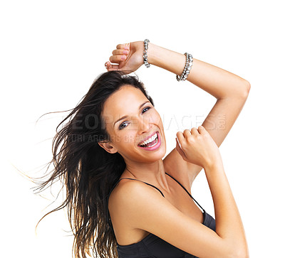 Buy stock photo Dancing young brunette smiling at the camera with her arms raised in a dance move- copyspace