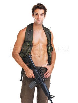 Buy stock photo Attractive young man in brown pants and a camouflaged vest holding an M16 rifle