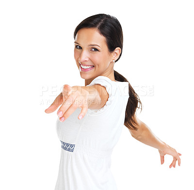 Buy stock photo Lovely brunette smiling while pointing at the camera in front of a white background