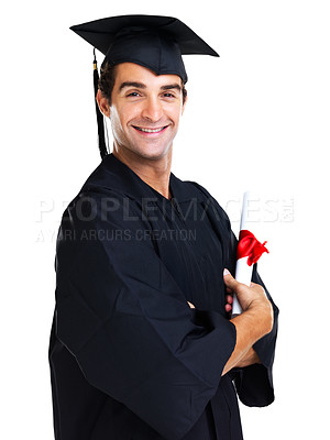 Buy stock photo Happy young graduate in a black gown and cap smiles at the camera while folding his arms