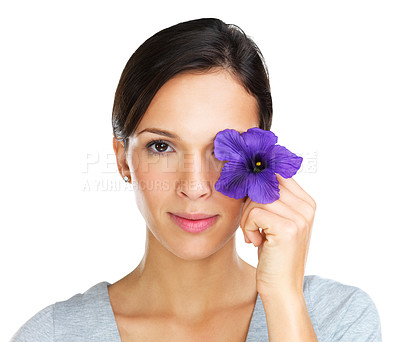 Buy stock photo Lovely brunette covering her one eye with a purple hisbiscus flower