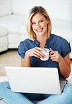 Woman with laptop having coffee