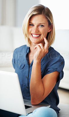 Buy stock photo Attractive Caucasian woman smiling using laptop at home