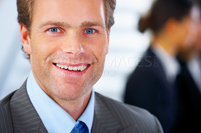 Buy stock photo Business man in his office with his colleagues in the background