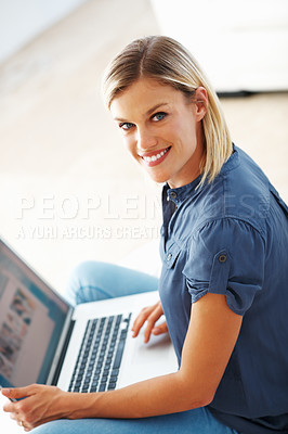 Buy stock photo Portrait of attractive middle aged woman smiling while using laptop