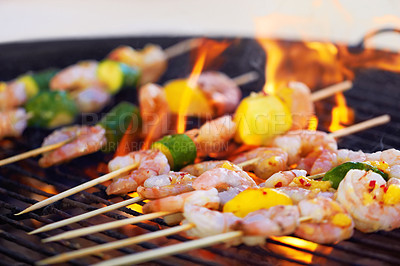 Buy stock photo Closeup of a prawn skewers cooking a the grill