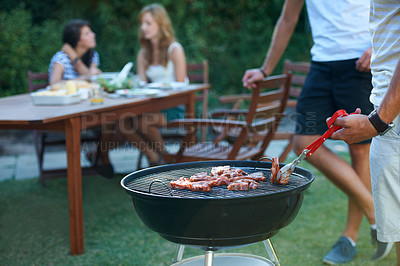 Buy stock photo Young guys barbecuing meat on the grill outdoors - Lifestyle