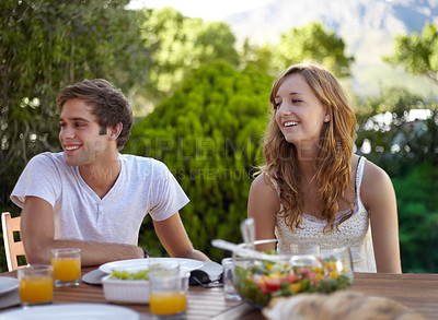 Buy stock photo Young teen couple sharing a healthy lunch together - focus on the foreground