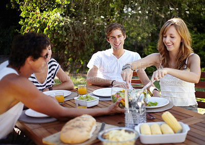 Buy stock photo Smiling young people at a lunch with a group of friends - portrait
