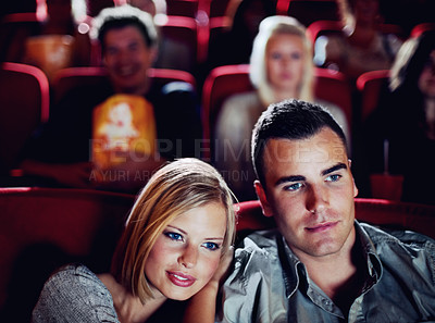 Buy stock photo A young couple out on a date at the movies