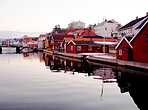 A scenic image of houses on a lake