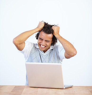 Buy stock photo Frustrated businessman sitting at his laptop