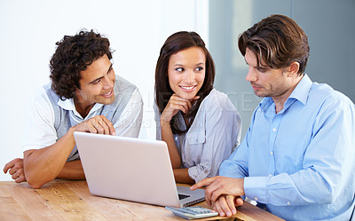 Buy stock photo A group of young entrepreneurs having a business meeting