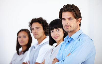 Buy stock photo A group of successful young entrepreneurs standing in a line together
