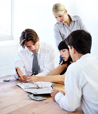 Buy stock photo Group of businesspeople working together as a team