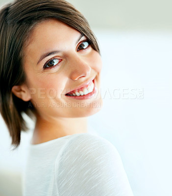 Buy stock photo A beautiful woman smiling candidly at the camera - closeup