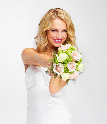 Buy stock photo Gorgeous young bride holding out her bouquet towards you - portrait