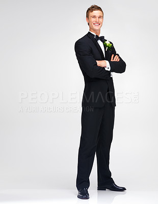 Buy stock photo Handsome young groom smiling while in his tuxedo