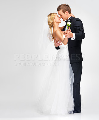 Buy stock photo Portrait of a cute newlywed couple embracing