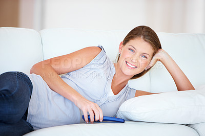 Buy stock photo Beautiful young woman relaxing at home on the couch - portrait