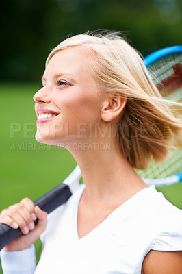 Buy stock photo A young tennis player with the wind in her hair and her racquet on her shoulder
